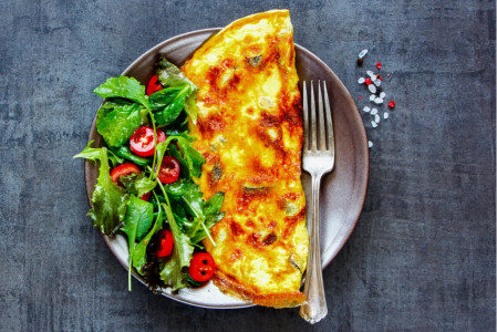 Omelette with spices and salad